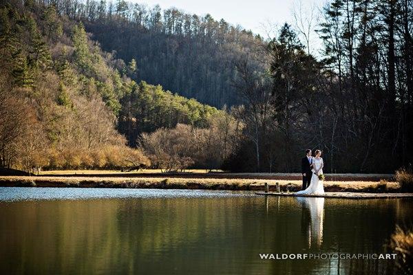 Bride and groom standing on the dock near their barn wedding near gatlinburg