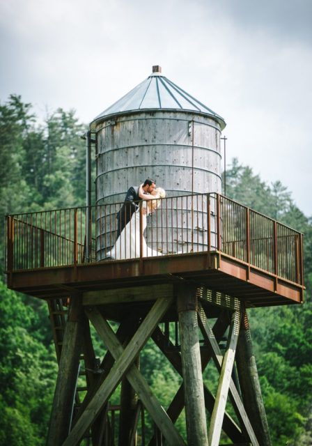 The couple kissing on the water tower- smoky mountain wedding packages all inclusive