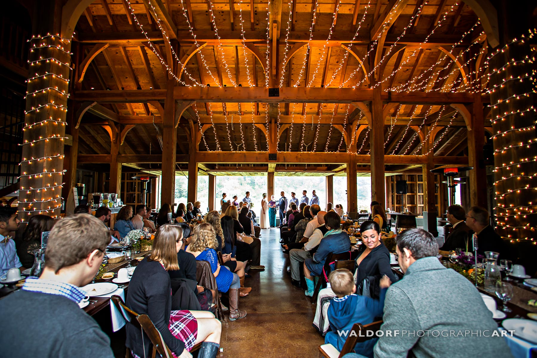 Indoor ceremony option in case of rain at Pure Water Farm barn wedding near Gatlinburg