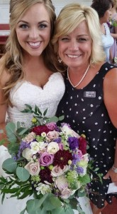 Wedding planner with a smiling bride holding her bouquet near Maryville TN
